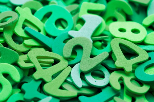 Random pile of green plastic numbers
